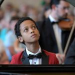 Pianist, Qden, Becomes First African Invited to Prestigious Masterclass in Germany